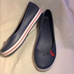 Crocs navy, with red and white trim